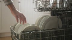 Emptying Dishwasher - Woman Doing House Chores Using Dish Washing Machine Stock Footage