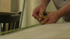 Carpenter Using Measuring Tape to Mark Section of Plywood Stock Footage