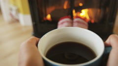 Woman Feet In Socks Relaxing Near Fireplace Getting Warm and Cozy In Winter - stock footage