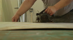 Carpenter Cutting Through Plywood with Circular Electric Saw Stock Footage