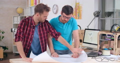 Engineers Discussing Drafts Stock Footage