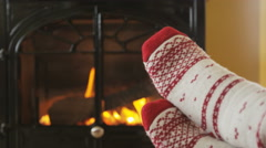 Woman Feet In Socks Getting Warm Against Fire Getting Warm and Cozy In Winter - stock footage