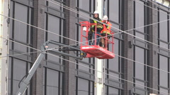 Construction workers await rescue after industrial accident Stock Footage