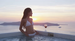 Woman In Bikini Enjoying Vacation At Resort Watching Sunset On Luxury Holidays - stock footage