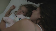 Mother Rest In Bed With Child Stock Footage