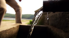 natural water gushes from spigot pipe close up - stock footage