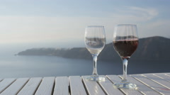 Red Wine glasses On Table In Romantic Nature - stock footage