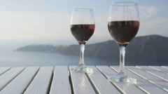 Wine glasses On Table Filled with Red Wine - romantic setting outdoors - stock footage