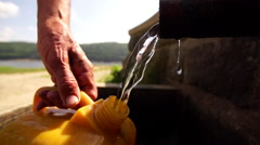 Natural water gushes from spigot pipe close up Stock Footage