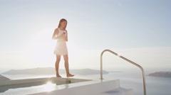 Elegant Woman With Wine Glass In Luxury Villa On travel, Santorini, Greece. - stock footage