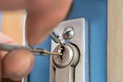 Close-up Of Lockpicker Hand Fixing Door Handle At Home Stock Photos