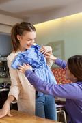 Women admiring clothes in cafe Stock Photos