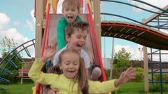 Summer Playtime, Two boys and cute girl having great fun Stock Footage