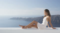 Relaxing Woman Enjoying View Of Caldera Santorini On Travel Vacation Holidays - stock footage