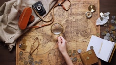 Old brass compass on wood table top view Stock Footage