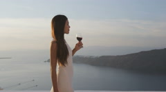 Attractive Woman Enjoying Vacation At Resort During Sunset Drinking Wine Stock Footage
