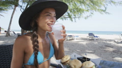 Happy Woman Having Snacks At Beach Restaurant On Travel Vacation Holidays - stock footage