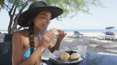 Happy Woman Eating Sandwich At Beach Restaurant On Travel Vacation Holidays - stock footage