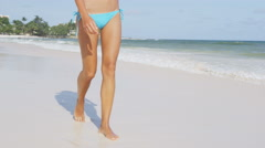 Woman In Blue Bikini Bottom Walking On Beach On Travel Vacation Holidays - stock footage