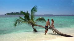 A couple in love kissing on a tropical beach. Maldivaes Stock Footage