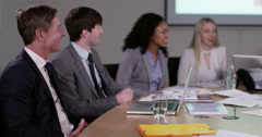 4k, A multi-ethnic group of business people at a board meeting and asking questi Stock Footage
