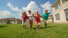 Best Summer Holidays, Four happy kids running Stock Footage