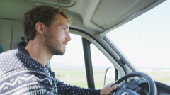 Young Man Driving Mobile Home Car - People in Motorhome on Roadtrip Stock Footage