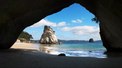morning shot of rock arch at cathedral cove - stock footage