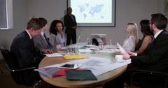 4k, Corporate business team in a boardroom meeting. Slow motion. - stock footage