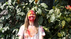 Colorized woman throws paint Stock Footage