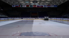 Preparation ice the game . The machine floods the ice. Hockey arena - stock footage