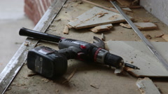 Carpenter Using Hammer and Power Drill to Demolish Building Interior - stock footage