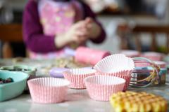 Close up of cupcake wrappers in kitchen - stock photo