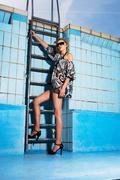 Woman wearing high heels in empty pool Stock Photos