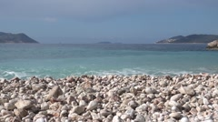 One third Wavy sea Pebbles and sky Stock Footage