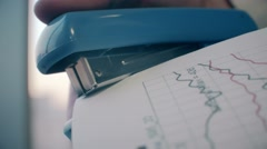 A hand using a stapler in an office Stock Footage