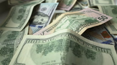 Dollar bills and coins - stock footage
