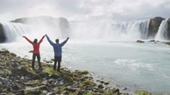 Couple Enjoying Serene Godafoss Waterfall - Active Healthy Living Concept - stock footage