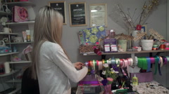 Girl prepares a gift wrapping ribbon Stock Footage