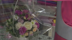 Florist preparing bouquet in gift shop Stock Footage
