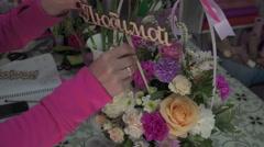 Florist preparing bouquet in gift shop - stock footage