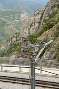 Railway contact line in Montserrat Abbey near Barcelona, Catalonia, Spain. - stock photo