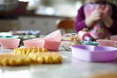 Close up of cupcake wrappers in kitchen Stock Photos