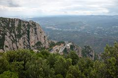 View towards Montserrat Abbey and valley bellow it, Barcelona, Spain. - stock photo