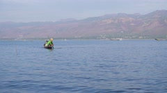 Fishermen in a canoe on famous Inle Lake Stock Footage