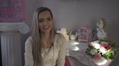 Pretty girl gives an interview in a flower shop Stock Footage