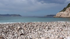 Wavy sea and pebbles on the beach Stock Footage