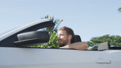 Driver Man Sitting In Convertible Car Against Sky - Young Urban Professional Stock Footage