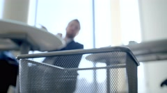 Man throws away paper documents Stock Footage