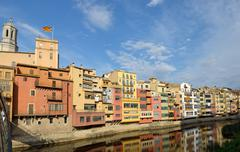 Old colorful houses on Onyar riverbank in Girona, Catalonia, Spain. - stock photo